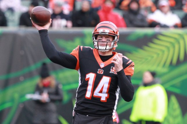 Cincinnati Bengals quarterback Andy Dalton (14) throws under pressure from the Chicago Bears' defense during the second half of play on December 10, 2017 at Paul Brown Stadium in Cincinnati. Photo by John Sommers II/UPI