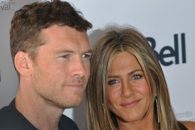 Sam Worthington, seen her with Jennifer Aniston, has signed on to star in a Netflix film to be directed by Brad Anderson. File Photo by Christine Chew/UPI