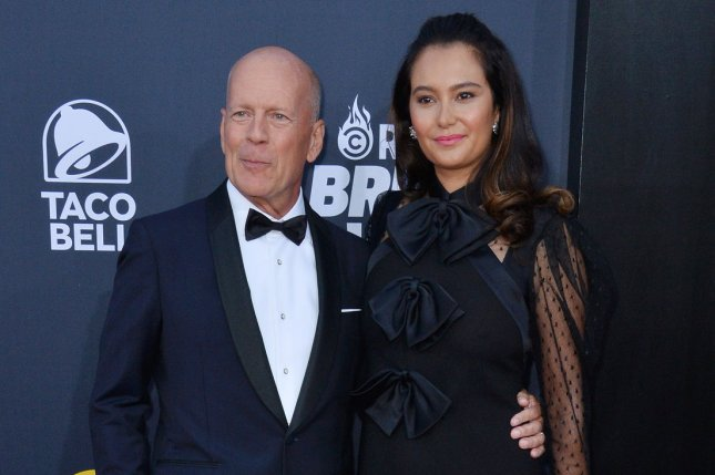 Bruce Willis (L) with his wife Emma Heming. Willis appears in the new teaser for Glass alongside James McAvoy and Samuel L. Jackson. File Photo by Jim Ruymen/UPI