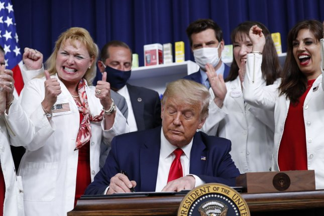 U.S. President Donald Trump signs an executive order on lowering drug prices in the Eisenhower Executive Office Building in Washington, D.C., on Friday. Photo by Stefani Reynolds/UPI