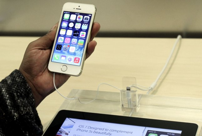 Most physicians keen to read online reviews written about them. A man holds the new Apple iPhone 5S at the Apple Store on 5th Avenue in New York City on September 20, 2013. UPI/John Angelillo