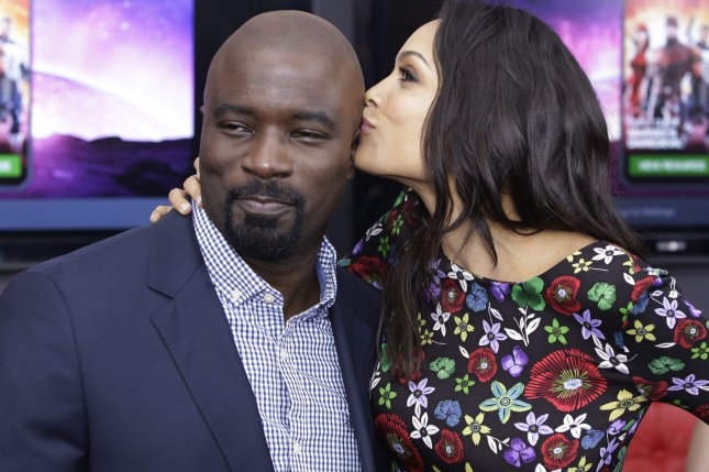 Luke Cage stars Rosario Dawson kissing Mike Colter when they arrive on the red carpet at the Daredevil Season 2 Premiere on March 10, 2016 in New York City. Netflix has released a new promotional photo and poster for the upcoming superhero drama. File Photo by John Angelillo/UPI