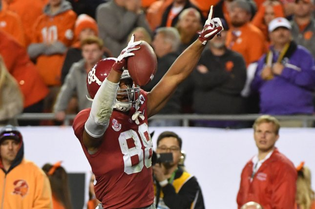 Tight end O.J. Howard #88 of the Alabama Crimson Tide celebrates after scoring a 68-yard touchdown in the third quarter against the Clemson Tigers in the 2017 College Football Playoff National Championship in Tampa, Florida on January 9, 2017. File photo by Kevin Dietsch/UPI