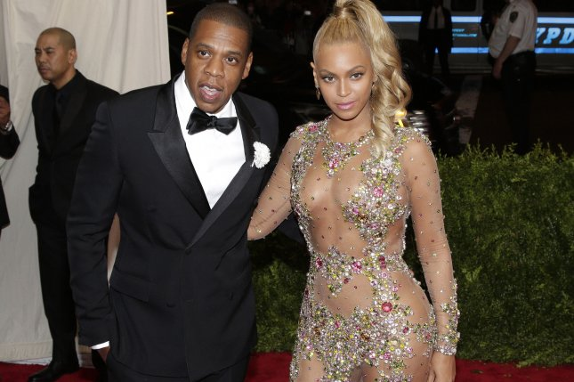 (L-R) Jay-Z and Beyonce arrive on the red carpet at the Costume Institute Benefit on May 4, 2015. Jay-Z's music streaming service Tidal is set to a hold a hurricane benefit concert. File Photo by John Angelillo/UPI