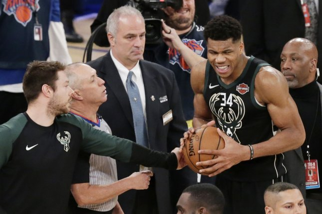 Milwaukee Bucks forward Giannis Antetokounmpo (R) reacts in overtime against the New York Knicks on December 1, 2018 at Madison Square Garden in New York City. Photo by John Angelillo/UPI