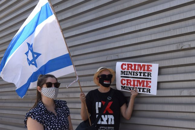 Israelis demonstrate during a nationwide COVID-19 lockdown, against Prime Minister Benjamin Netanyahu's proposed bill to restrict protests, outside the Knesset, the Parliament, on Tuesday in Jerusalem. Photo by Debbie Hill/UPI