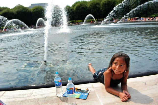 Andres Funes, 6, cools off in a fountain at the National Sculpture Garden, on the National Mall in Washington on July 3, 2011. UPI/Kevin Dietsch