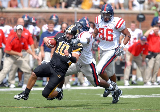 Missouri Tigers Chase Daniel 10 Is Pulled Down From Behind By Ole Miss Rebels Mico McSwain During A Run In The First Quarter At Faurot Field Columbia