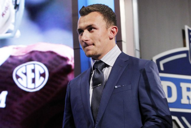 Ex-Texas A&M quarterback Johnny Manziel walks on the stage before the start of the 2014 NFL Draft at Radio City Music Hall in New York City on May 8, 2014. (File/UPI /John Angelillo)