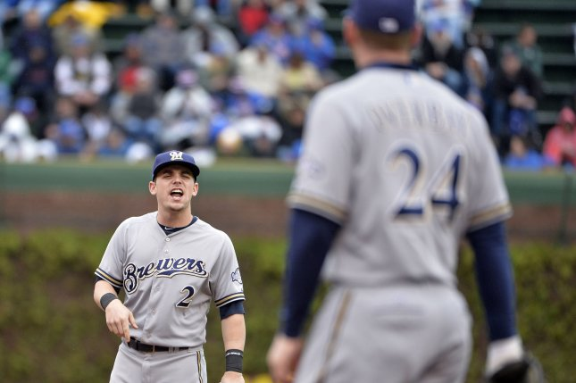 Milwaukee Brewers second baseman Scooter Gennett (L) talks with first baseman Lyle Overbay during the first inning against the Chicago Cubs at Wrigley Field in Chicago on May 16, 2014 in Chicago. UPI/Brian Kersey