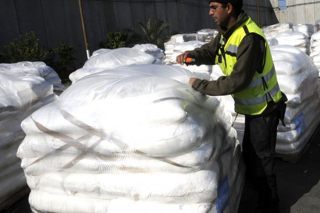 A worker checks humanitarian aid consisting of medical supplies, food and grain at the Kerem Shalom crossing on the Gaza border before it is reloaded on Palestinians trucks and delivered to Gaza, January 12, 2009. (UPI Photo/Debbie Hill)