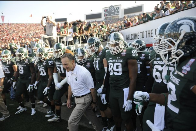 Michigan State Spartans Head Coach Mark Dantonio leads the team to the field. File photo by Lori Shepler/UPI