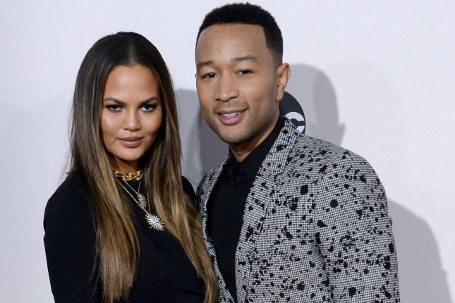 Model Chrissy Teigen (L) and singer John Legend arrive for the 2016 American Music Awards held at Microsoft Theater in Los Angeles on November 20, 2016. The couple attended President Obama's farewell to the White House party on Friday night. File Photo by Jim Ruymen/UPI
