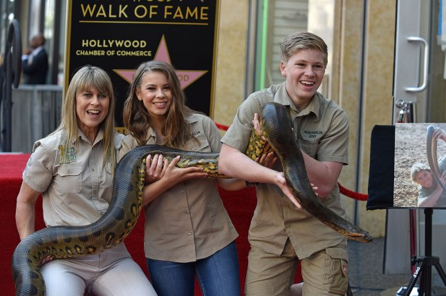 Bindi Irwin (C), pictured with Terri Irwin (L) and Robert Irwin, paid tribute to Steve Irwin on the anniversary of his death. File Photo by Christine Chew/UPI