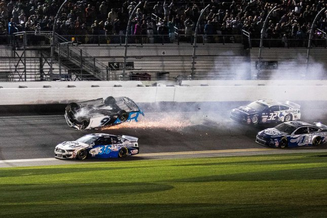 David Ragan (36) maneuvers by the inverted car of Ryan Newman at the finish of the 62nd annual Daytona 500 on Monday night at Daytona International Speedway in Daytona Beach, Fla. Photo by Edwin Locke/UPI