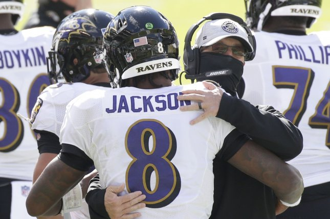 Baltimore Ravens quarterback Lamar Jackson (8) celebrates with head coach John Harbaugh after a touchdown against the Philadelphia Eagles on Sunday at Lincoln Financial Field in Philadelphia. Photo by John Angelillo/UPI