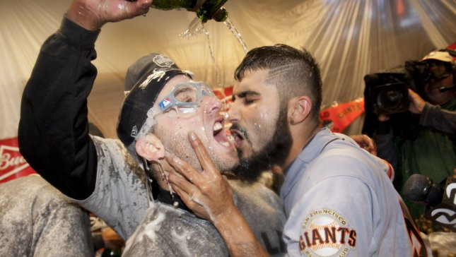 San Francisco Giants' Sergio Romo (R) kisses teammate Marco Scutaro as they celebrate after game 4 of the World Series at Comerica Park on October 28, 2012 in Detroit. The Giants won 4-3, sweeping the Detroit Tigers 4-0 to win the World Series. UPI/Kevin Dietsch