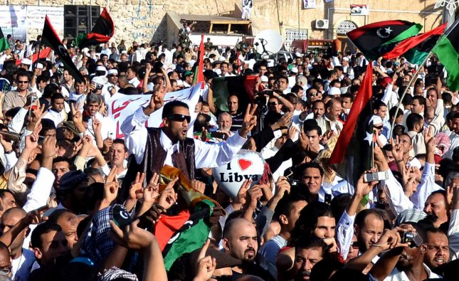People gather at Martyr Square, formerly known as Green Square, for Eid Al-Fitr prayer on August 31, 2011 in Tripoli, Libya. Libyans came together to celebrate their first Eid Al-Fitr in 42 years under a new regime. UPI/Tarek Elframawy