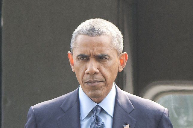United States President Barack Obama arrives at the Walter Reed National Military Medical Center in Bethesda, Maryland on Tuesday, July 29, 2014, following his statement at the White House concerning additional sanctions on Russia for their involvement in Ukraine. UPI/Ron Sachs/Pool