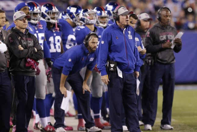 New York Giants head coach Tom Coughlin stands on the field in the first quarter against the San Francisco 49ERS at MetLife Stadium in East Rutherford, New Jersey on October 11, 2015. Photo by John Angelillo/UPI