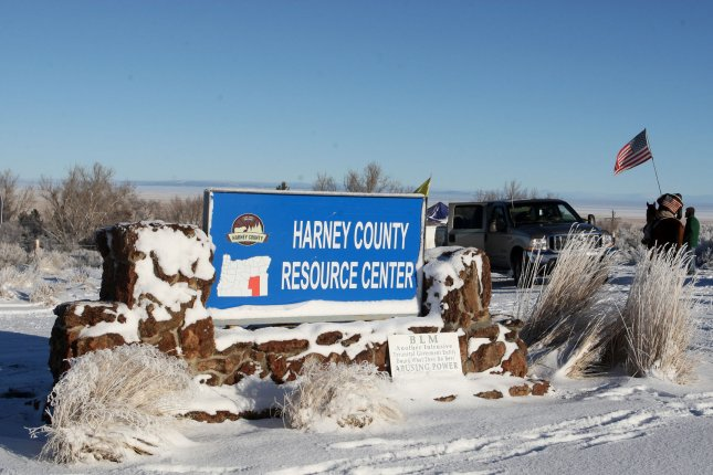 The remaining armed occupiers at an Oregon wildlife refuge said they would turn themselves in, hours after Cliven Bundy, the father of the protest leader, was arrested Thursday. Above, the entrance sign at the Malheur National Wildlife Reserve was changed to Harney County Research Center on January 15 in Burns, Oregon. Photo by Jim Bryant/UPI