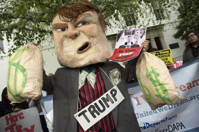 A protester dressed as Donald Trump demonstrates outside the Republican National Committee headquarters Thursday as Trump met with Speaker of the House Paul Ryan and RNC Chairman Reince Priebus in Washington, D.C. Photo by Kevin Dietsch/UPI