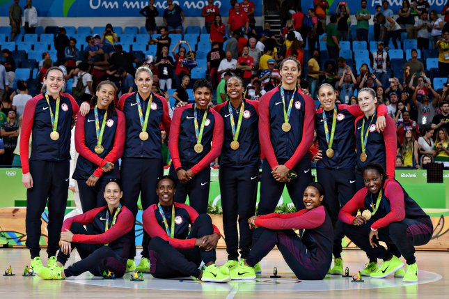 Members of the United States Women's Basketball team pose with their gold medals after winning the Women's Basketball gold medal game in the Carioca Arena 1 at the 2016 Rio Summer Olympics in Rio de Janeiro, Brazil, on August 20, 2016. The USA beat Spain for the gold 101-72. Photo by Richard Ellis/UPI