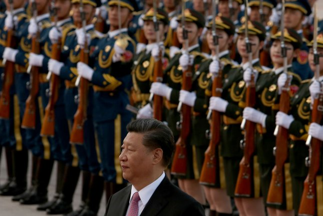 Chinese President Xi Jinping has yet to resolve a trade dispute with the United States. China was not labeled a currency manipulator in Washington on Tuesday, but was placed on a monitoring list. File Photo by Stephen Shaver/UPI