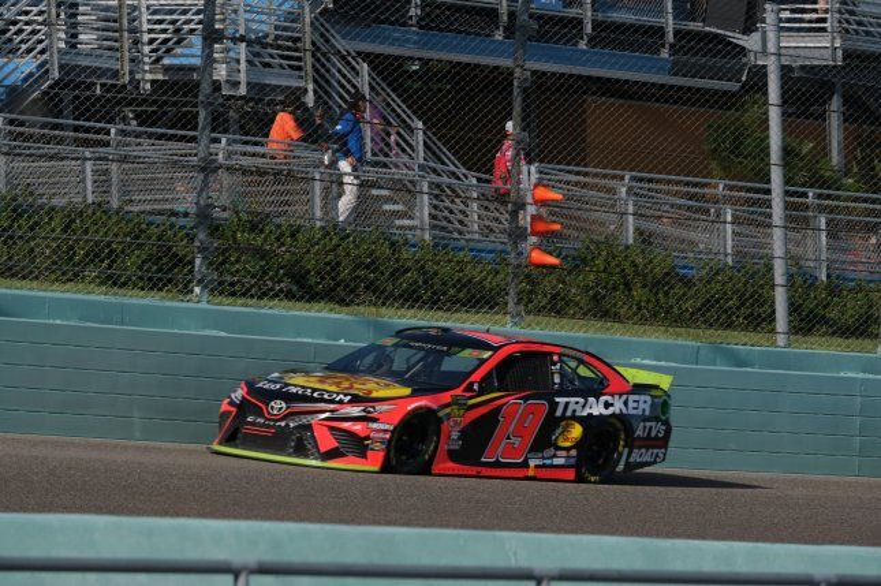 Martin Truex Jr. (19) and Joe Gibbs Racing teammate Denny Hamlin will start on the front row in Monday's race. File Photo By Gary I Rothstein/UPI