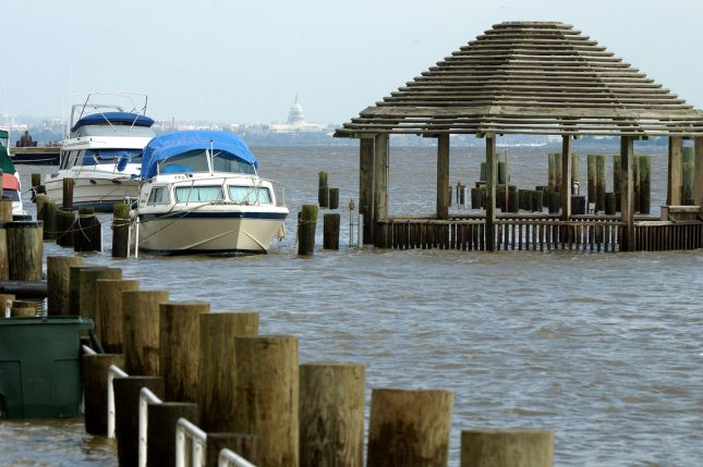 A swollen Potomac River covers the waterfront walkway and half of a gazebo in Alexandria, Va., after Hurricane Isabel slammed the East Coast on September 19, 2003. The storm caused major flooding along the Mid-Atlantic, including on the abandoned Portsmouth Island, N.C., which was abandoned in 1971. File Photo by Roger Wollenberg/UPI