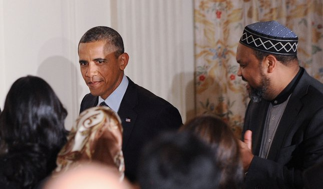 U.S. President Barack Obama speaks at an Iftar dinner celebrating Ramadan in the State Dining Room of the White House August 10, 2012 in Washington, DC. UPI/Olivier Douliery/Pool