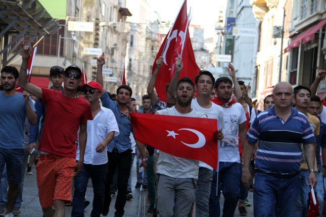 People wave Turkish flags during a demonstration in support of the Turkish president in Istanbul, Turkey on July 16, 2016. President Recep Tayyip Erdogan battled to regain control over Turkey on July 16, 2016 after a coup that claimed more than 250 lives. The air space around an air base in Turkey used by the U.S. for anti-Islamic State missiions, was temporarily shut down as a result of the coup, but as since reopened. Photo by Hanna Noori/ UPI