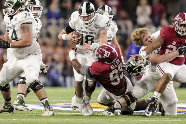 Alabama defensive lineman Jonathan Allen (93) sacks Michigan State quarterback Connor Cook (18). Allen, along with many other defensive prospects, form one of the better defensive classes in the NFL Draft's history. File photo by Michael Prengler/UPI