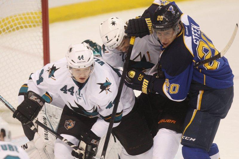 Marc-Edouard Vlasic (44) of the San Jose Sharks tries to block a shot against the St. Louis Blues. UPI/Bill Greenblatt