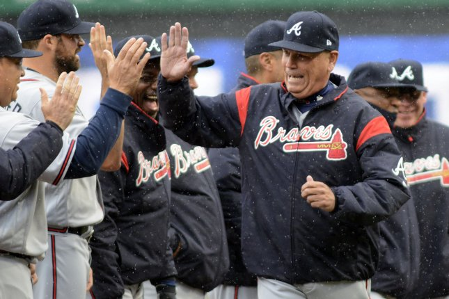 Atlanta Braves manager Brian Snitker greets his players before the start of a recent game. Snitker and the Braves topped the Washington Nations on Thursday. Photo by Archie Carpenter/UPI