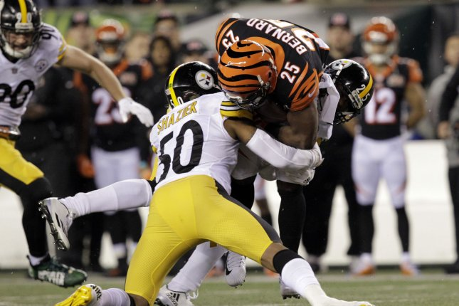 d373b89e6a1 Cincinnati Bengals half back Giovani Bernard (25) is tackled by Pittsburgh  Steelers  Ryan Shazier (50) during the first half of play at Paul Brown  Stadium ...