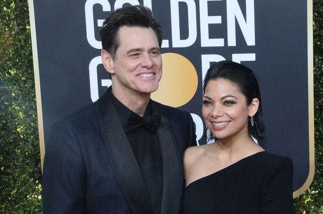 Jim Carrey (L) and Ginger Gonzaga attend the Golden Globe Awards on Sunday. Photo by Jim Ruymen/UPI