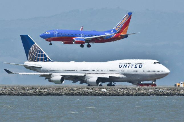 Southwest's plans to offer flights to Hawaii are in a holding pattern due to the government shutdown. United could be affected by delayed launch of commercial service at a Washington state airport. File Photo by Terry Schmitt/UPI