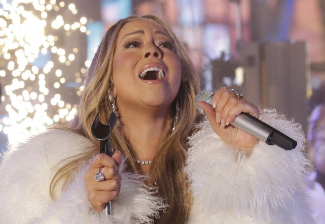 Mariah Carey performs in Times Square on New Year's Eve in New York City on Tuesday. Her modern Christmas classic All I want for Christmas is You is the first No. 1 song of 2020, making Carey the first-ever artist to have topped the U.S. song chart in four decades. Photo by John Angelillo/UPI