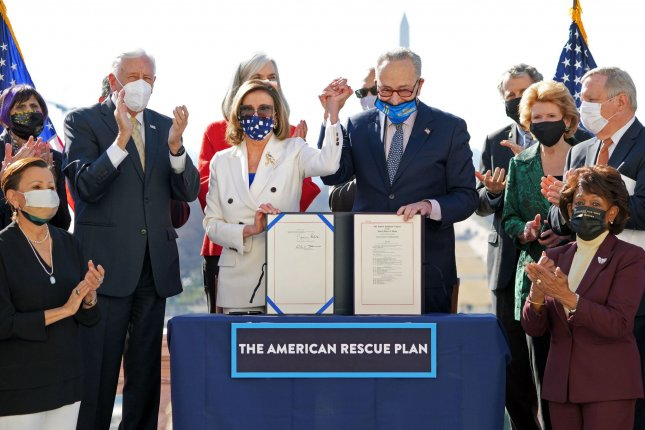 House Speaker Nancy Pelosi and Senate Democratic leader Chuck Schumer praised Democrats for working together as the House passed the $1.9 trillion American Rescue Plan. Photo by Kevin Dietsch/UPI