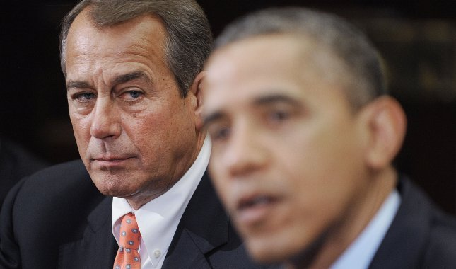 U.S. House Speaker John Boehner, R-Ohio, (L) listens as President Barack Obama speaks at a meeting with congressional leaders at the White House in Washington, Nov. 16, 2012. UPI/Olivier Douliery/Pool