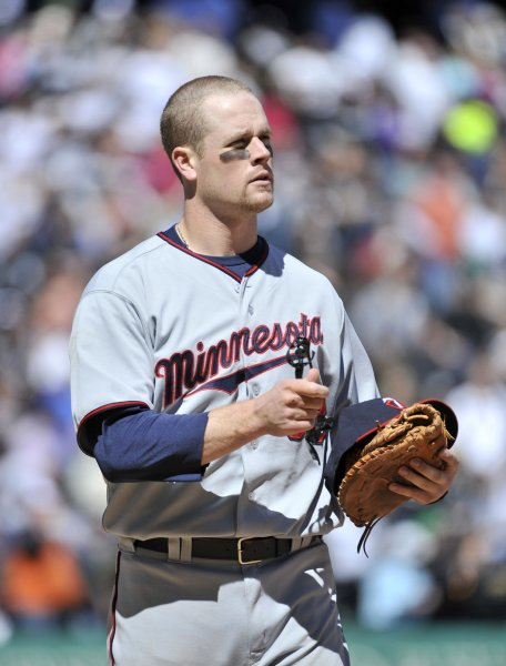 Minnesota Twins' Justin Morneau stands on the field after he was caught stealing to end the seventh inning against the Chicago White Sox at U.S. Cellular Field in Chicago on May 4, 2011. The Twins won 3-2. UPI/Brian Kersey