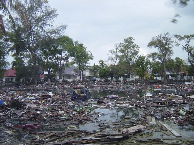 An area of Aceh, Sumatra, in Indonesia is littered with debris following a massive Dec. 26, 2004, Indian Ocean earthquake-tsunami. This photo was taken five days after the disaster, which had a death toll of at least 225,000. Photo by Michael L. Bak/U.S. Navy/UPI File
