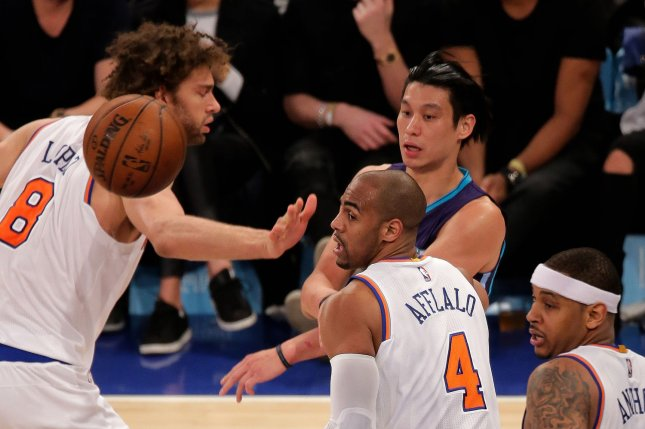 Former Charlotte Hornets guard Jeremy Lin (7) unloads a pass over New York Knicks center Robin Lopez (8), guard Arron Afflalo (4) and forward Carmelo Anthony (7) at Madison Square Garden in New York City on April 6, 2016. Photo by Ray Stubblebine/UPI