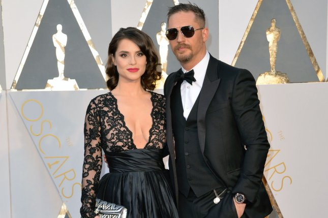 Charlotte Riley and Tom Hardy arrive on the red carpet during the 88th Academy Awards in Los Angeles on February 28. The trailer for Hardy's new TV series Taboo is now online. File Photo by Kevin Dietsch/UPI