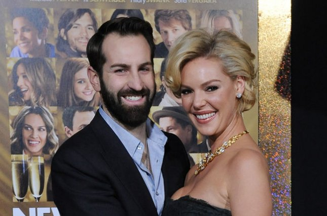 Katherine Heigl, a cast member in the romantic comedy motion picture New Year's Eve, attends the premiere of the film with her husband Josh Kelley at Grauman's Chinese Theatre in Los Angeles on December 5, 2011. The actress shared a photo of her husband on his birthday cuddling newborn Joshua Bishop. File Photo by Jim Ruymen/UPI