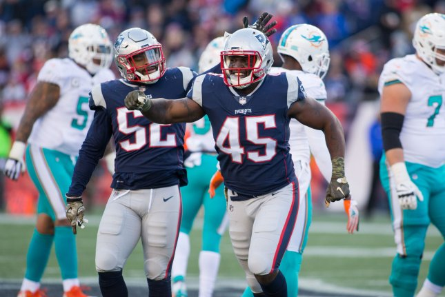 63fc8ff3975 New England Patriots linebackers David Harris (45) and Elandon Roberts (52)  celebrate a fumble recovery in the third quarter against the Miami Dolphins  on ...