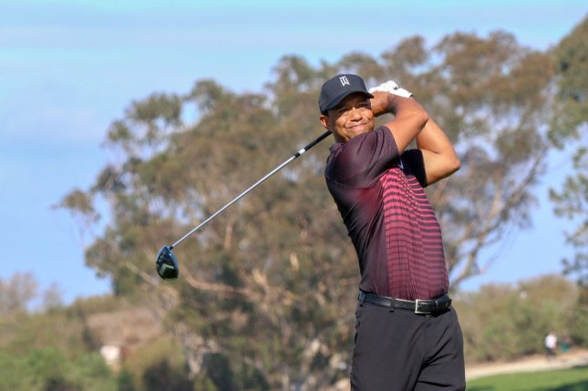 Tiger Woods drives the 4th hole during the first round of the Farmers Insurance Open on January 25 at Torrey Pines in San Diego, Calif. Photo by Howard Shen/UPI
