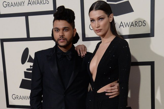 The Weeknd (L), pictured with Bella Hadid, confirmed his rekindled romance with the model on her birthday. File Photo by Jim Ruymen/UPI