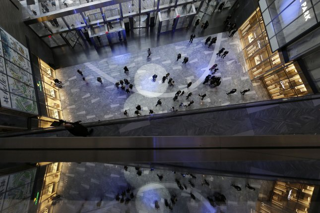 Shoppers canvass the Hudson Yards shopping district in New York City at its grand opening on March 14. File Photo by John Angelillo/UPI
